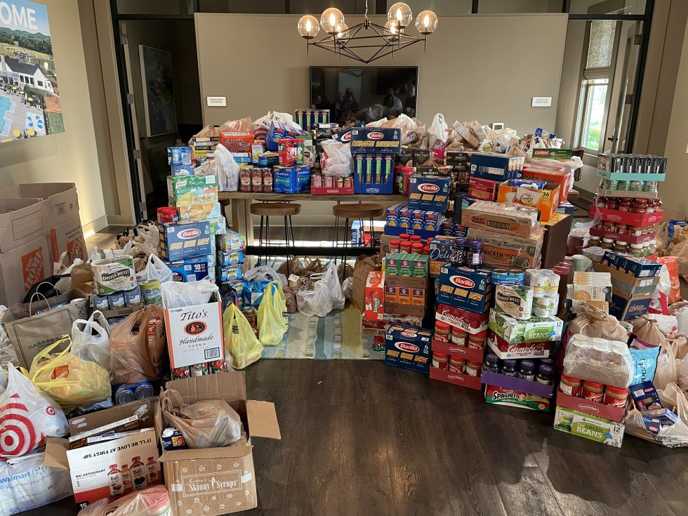 """Durham Farms' residents collect, donate 12,000 pounds of food during """"Battle of the Streets"""" food drive"""